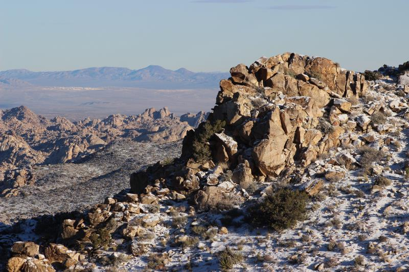 Rocks with snow in morning on Ryan Mountain