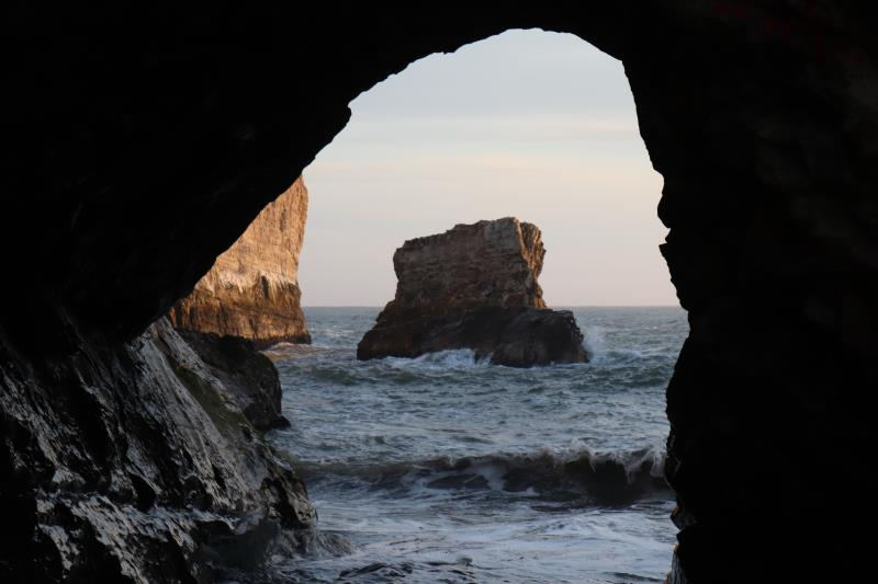 Looking through opening on beach at Shark Fin Cove