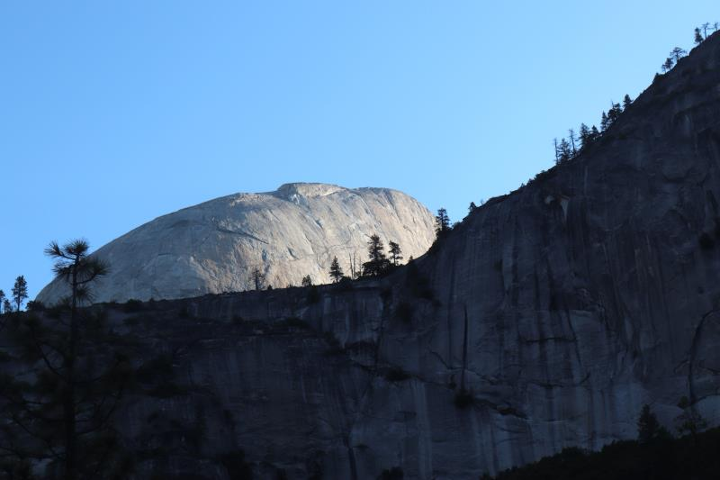 Half Dome peaking out in morning sunlight