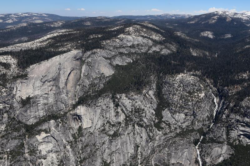 View from top of Half Dome with waterfall in distance