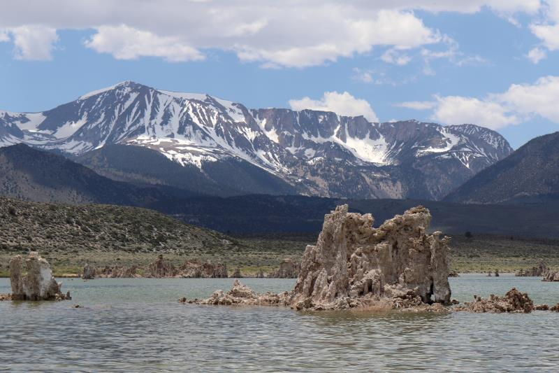 Mono Lake tufa tower with mountains in background
