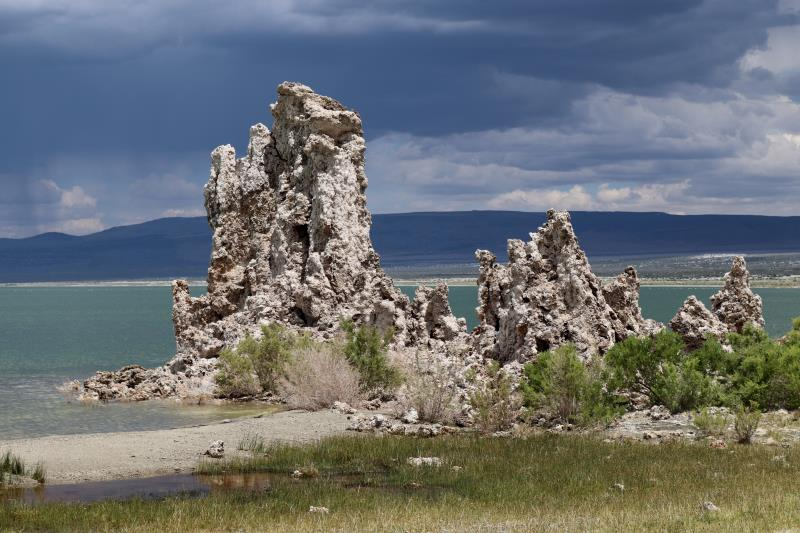 Mono Lake tufa towers along shore with storm clouds