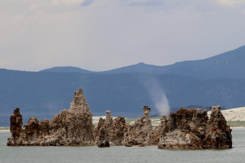 Mono Lake tufa towers with dust storm cloud in background