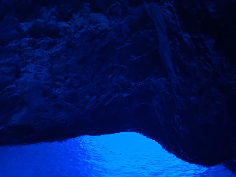 Inside Blue Cave with blue cave walls