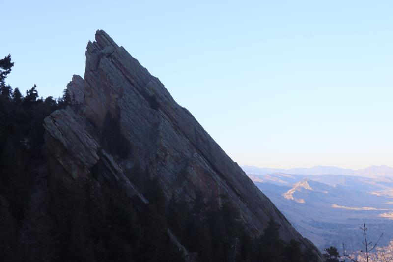 Flatiron with a climber at top seen from Royal Arch