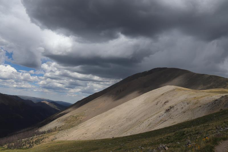 Looking back at San Luis Peak with dark clouds