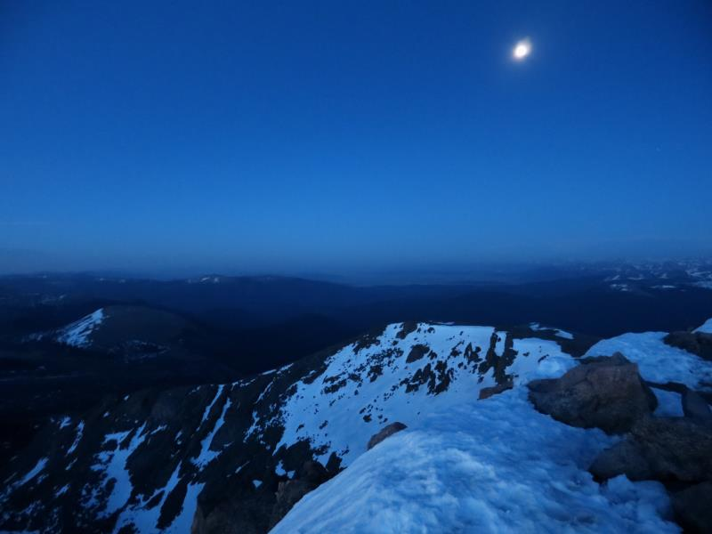At the summit of Bierstadt before sunrise with almost full moon