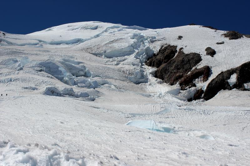 Looking up towards the summit from Ingraham Flats with climbers on left