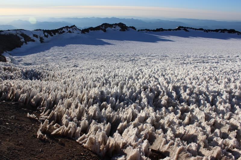 View of Crater Rim on summit of Mt. Rainier with heavily suncupped snow