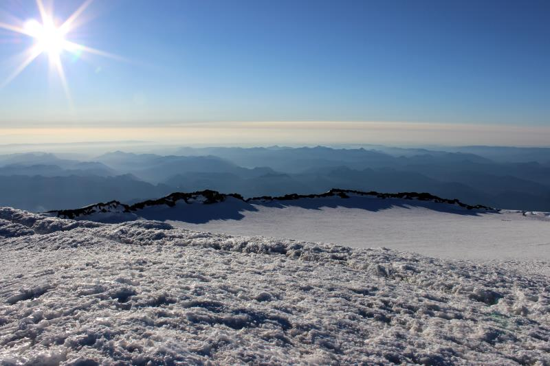 View of Crater Rim on summit of Mt. Rainier with climbers on the right