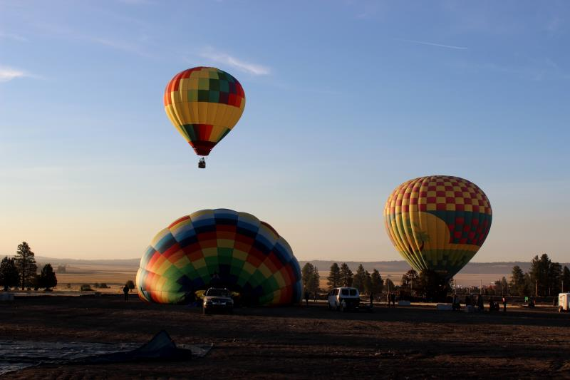 First hot air balloons taking off on Sunday