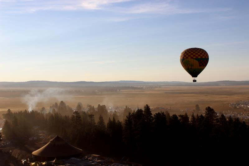 Hot air balloon hovering over festival