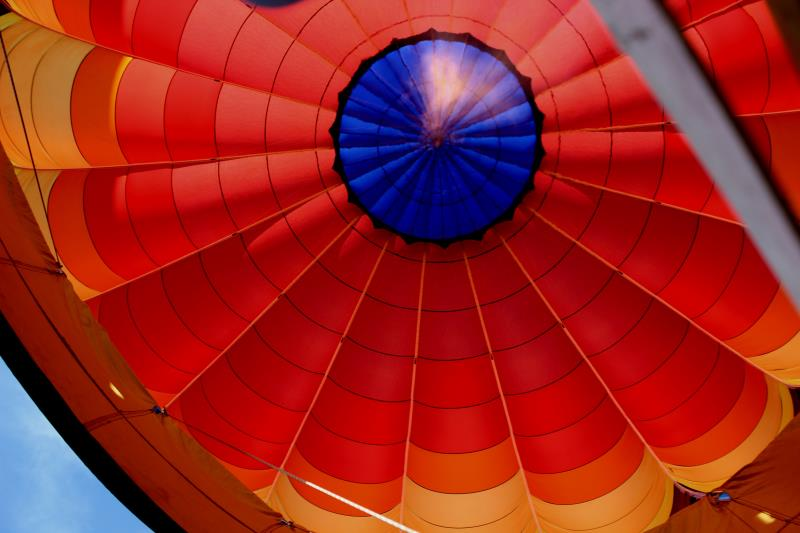 Looking up into fire from helium into hot air balloon