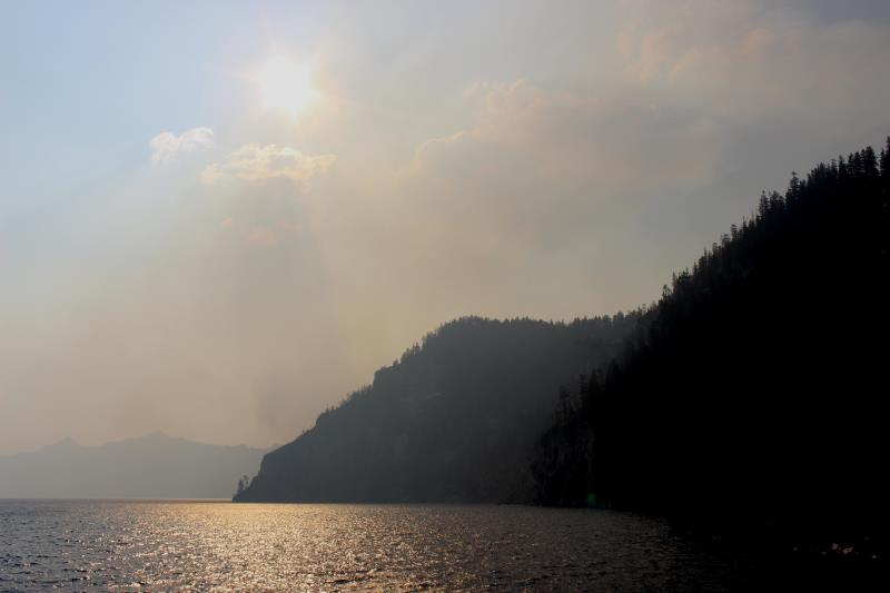 Sun shining through forest fire smoke on Crater Lake