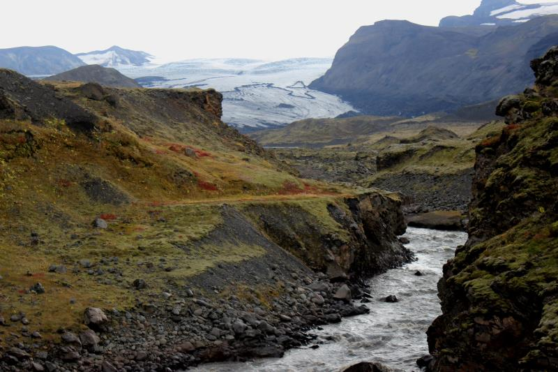 River with glacier in distance seen while heading towards Þórsmörk Valley