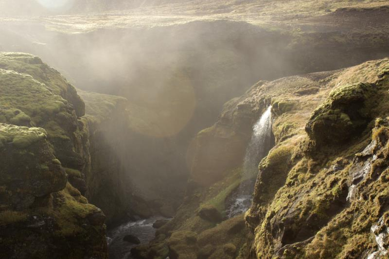 Small waterfall with mist on Fimmvörðuháls Trail