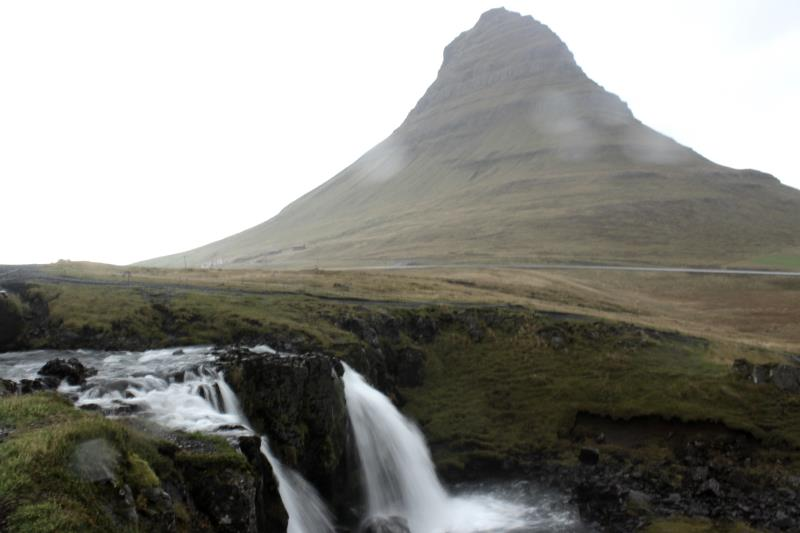 Waterfall with Kirkjufell Mountain in background while it was raining