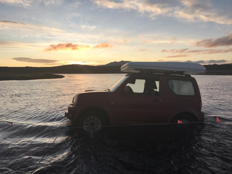 My Suzuki Jimny stuck in large river with flat tire