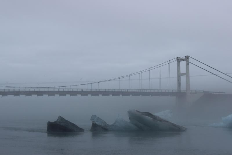 Bridge with icebergs seen from land