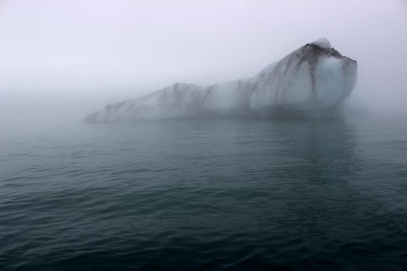 Darker iceberg seen from boat