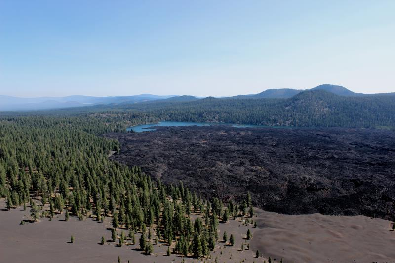 View of Butte Lake and Fantastic Lava Beds from Cinder Cone with smoke from forest fires in distance