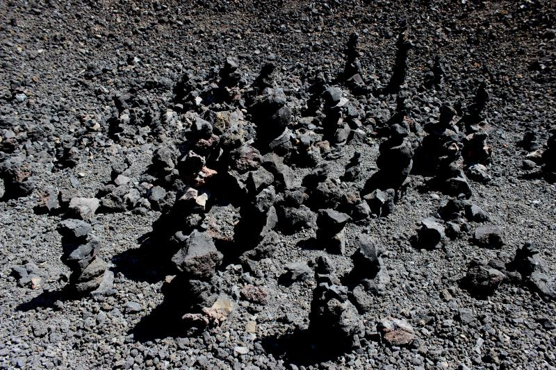 Rocks people have stacked at base of Cinder Cone's center